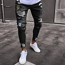 92d360ad2d Men Feet Badge Jeans Men  039 s Trends Knee Hole Zipper Feet Hole Denim