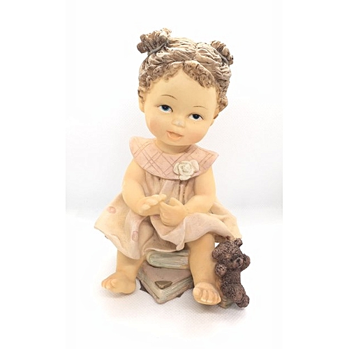 Figurine : Small Girl In Pink On Books
