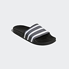 79c6e0e1614c Men  039 s Adilette Slides - Core Black   Cloud White   Core Black