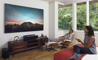 "4K Smart Laser TV 100"" 2017 model 100L8D bedroom daytime couple watching"