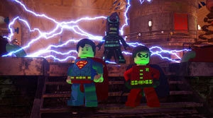 Superman, Batman, and Robin posing in a dramatic pose together in Lego Batman 2: DC Super Heroes