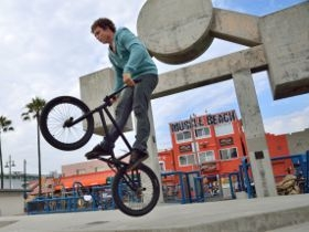 Picture of a BMX bike rider in mid-air.