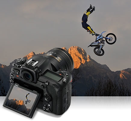 D500 photo of a motorcross rider in air with the D500 inset and the same photo on the camera's LCD