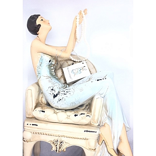 Figurine : Tall Lady On Chair Looking At Raised Beads