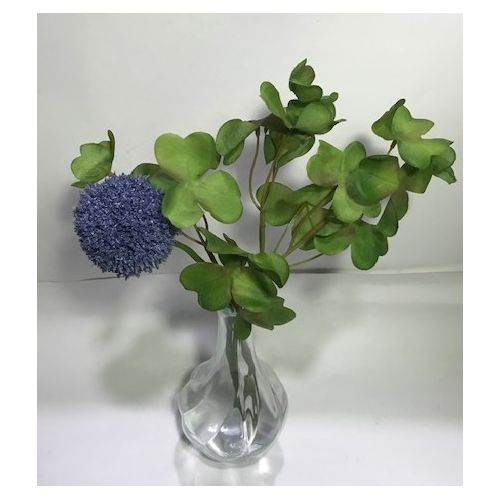 Blue Flower In Clear Glass Vase